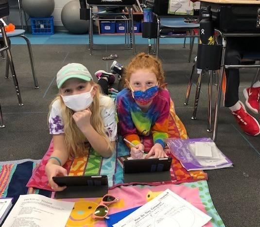 Two 4th Grade Students Working on iPads on beach day