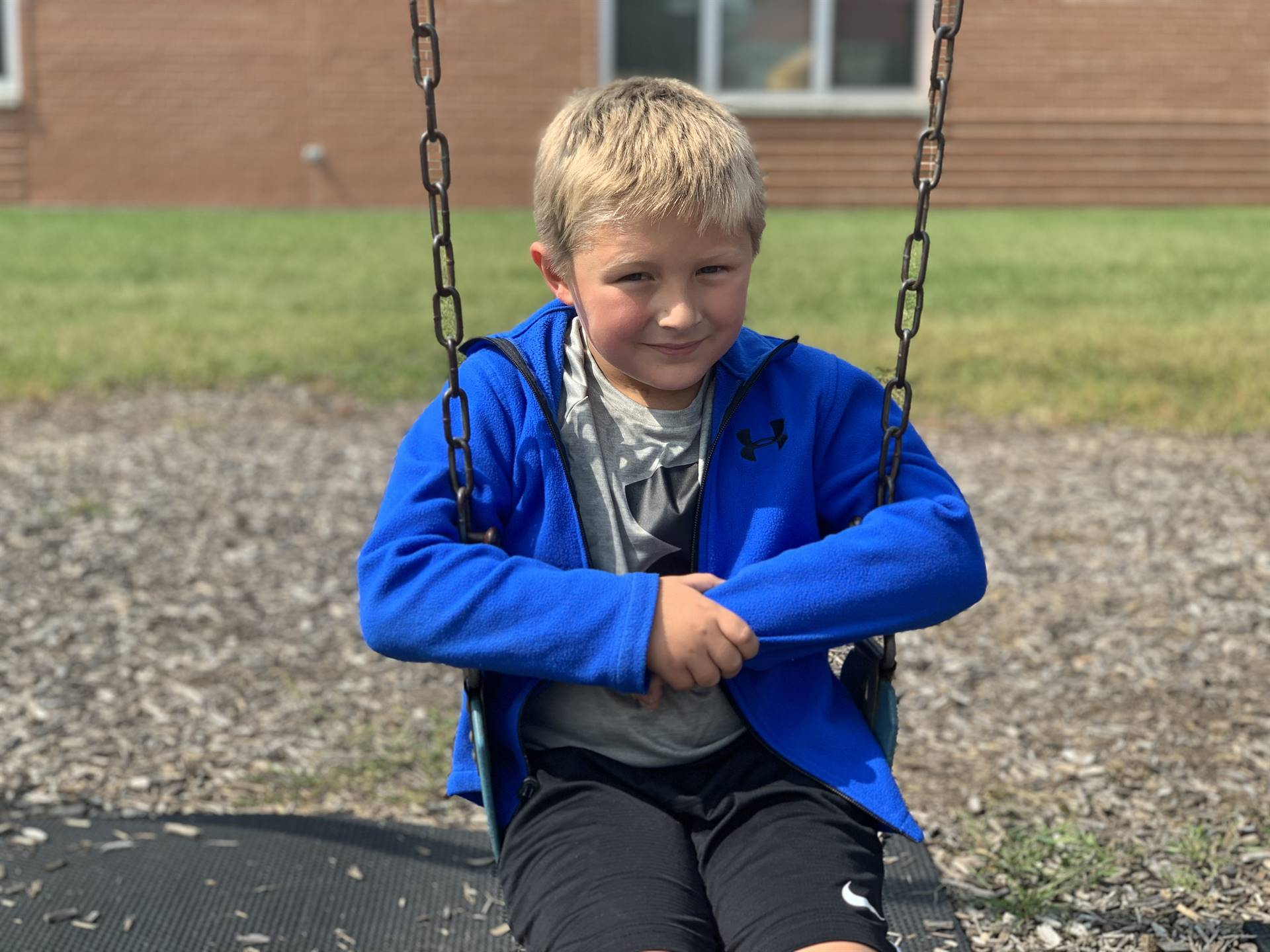 1st grader swinging