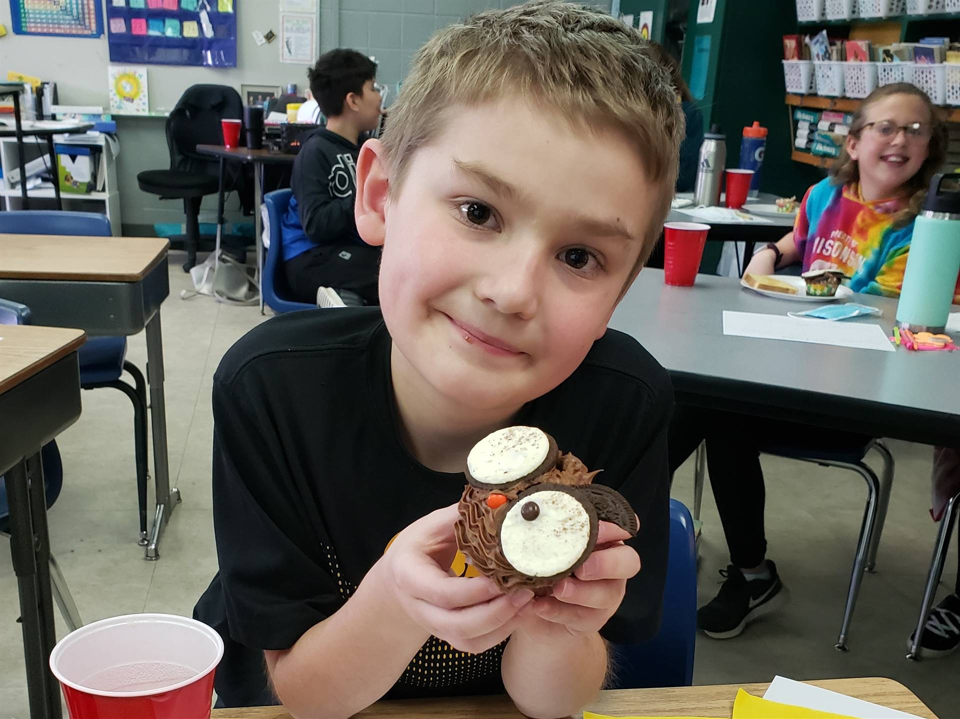 Student smiling with cupcake