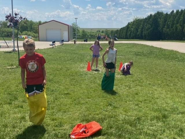 Two 4th grade students during potato sack race