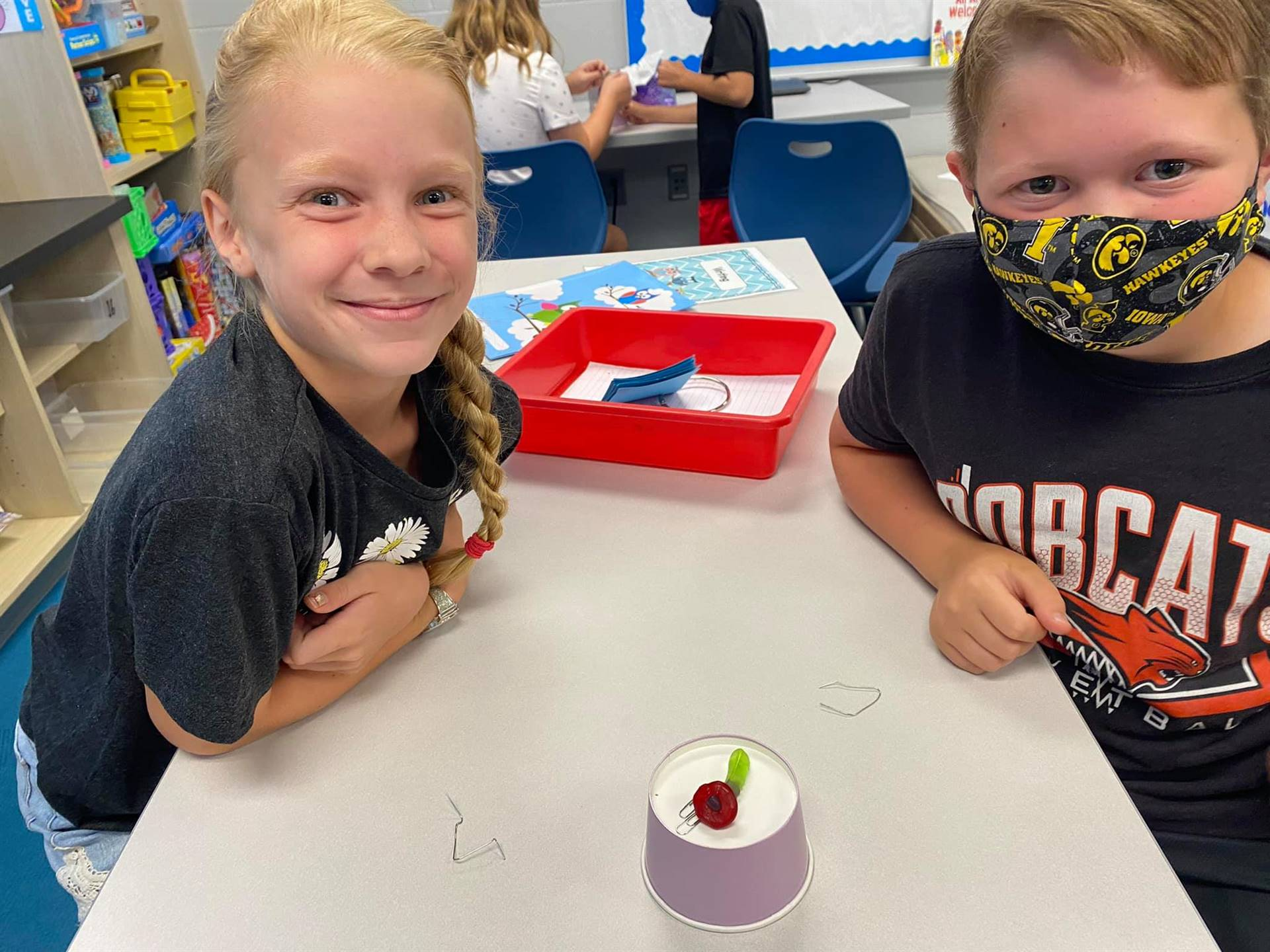 Two 3rd grade students with gummy worm