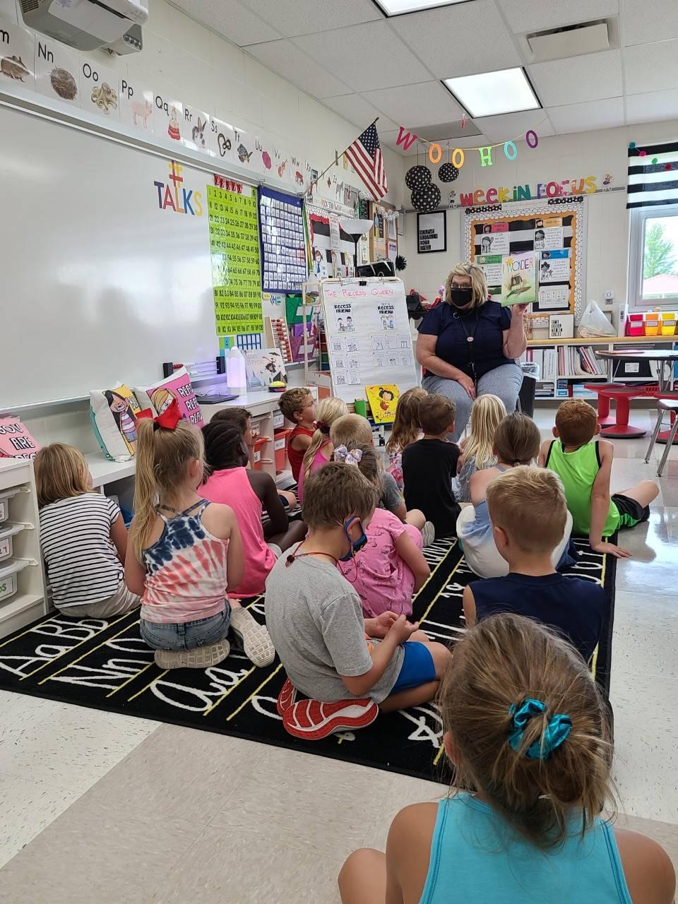 Principal reading to first grade class