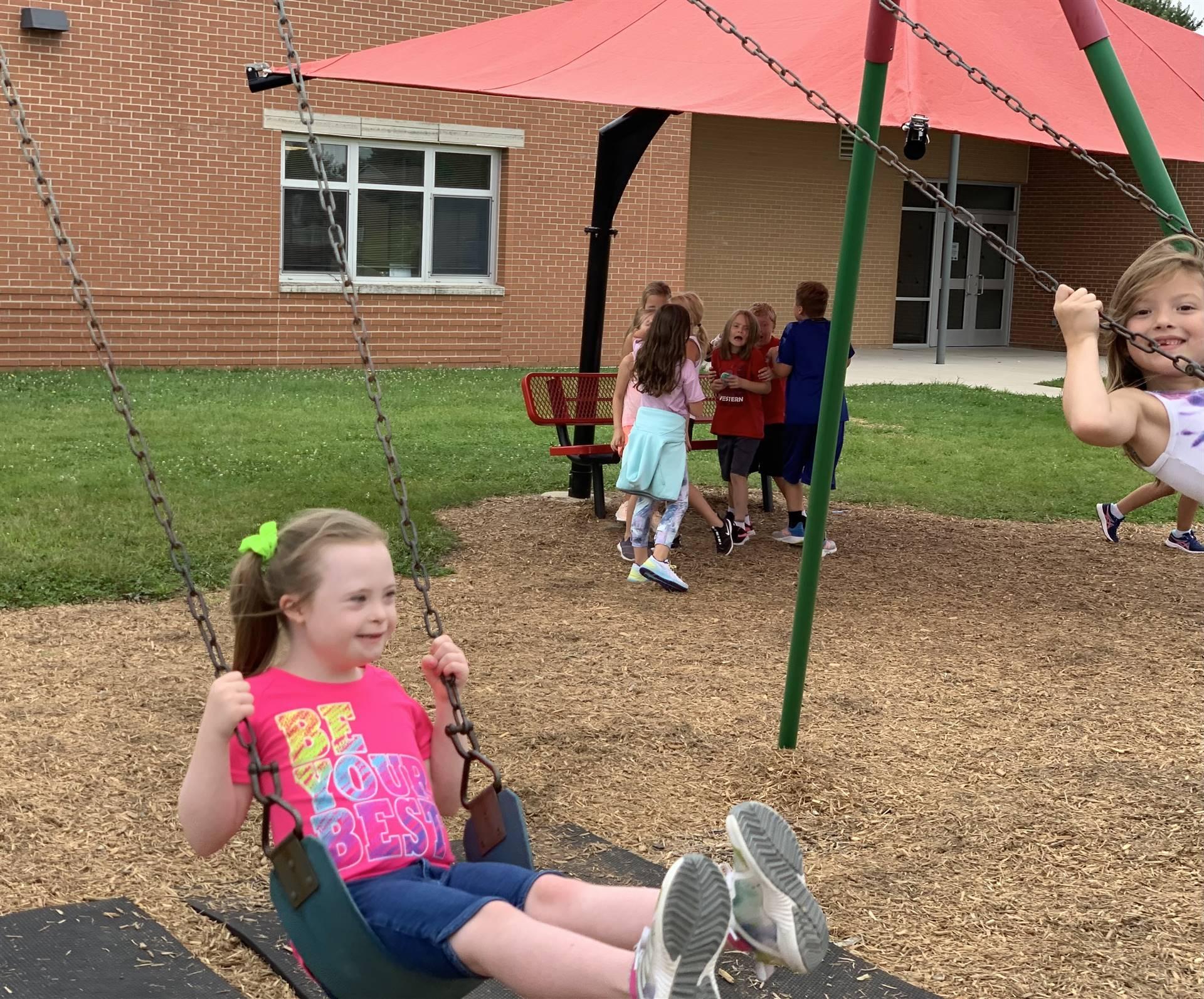 3rd graders swinging
